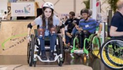 Photo: Girl skating with her wheelchair in the skate park at REHACARE